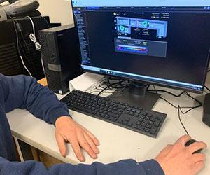 Man sitting at computer McCarl's careers